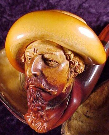 A Buffalo Bill Cody meerschaum pipe illustrating the coloring of a pipe that occurs with regular smoking.