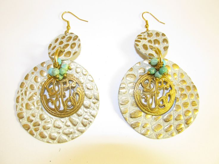 Handmade leather earrings (1 pair)  Made with embossed beige/gold leather, mat gold metal filigree and turquoise stones.
