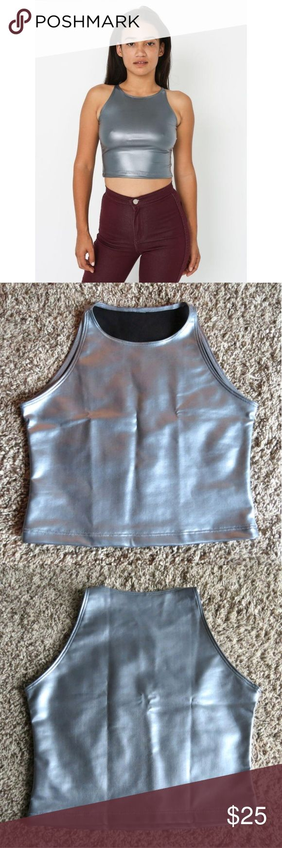 NWOT AA Silver Crop Top No trades! Awesome high neck sleeveless silver metallic crop top by American Apparel. Tight fitting but stretchy. NWOT never worn. Size M. American Apparel Tops Crop Tops