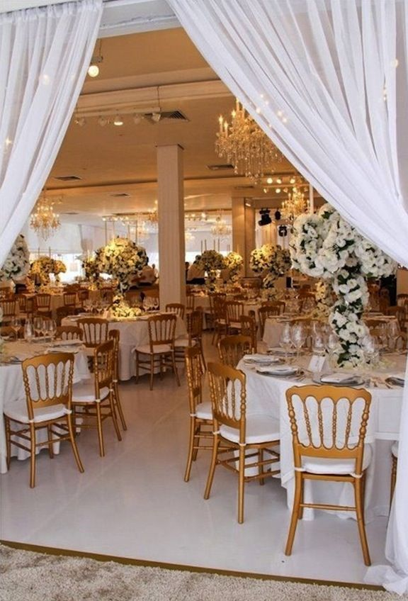 Wedding Reception Table With Tall Arrangements Of White Roses