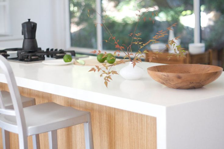 desire to inspire | The Baudelaire family home | Love the wood grain recessed under the kitchen island bench