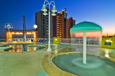 A nighttime view of the Pool area at the Prince Resort at the Cherry Grove Pier!