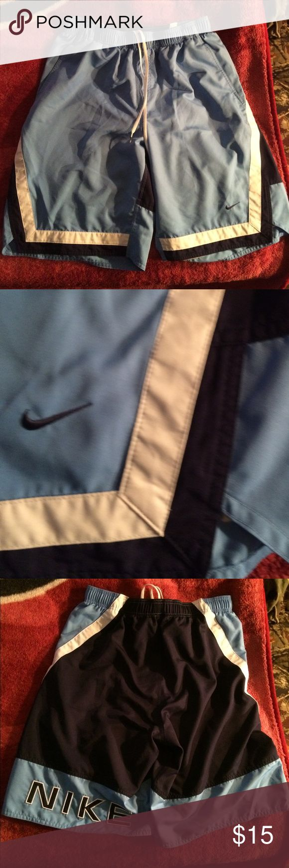 Nike swim trunks great condition XL Blue white and black Nike swim trunks no stains no rips or tears. In very good condition Nike Swim Swim Trunks