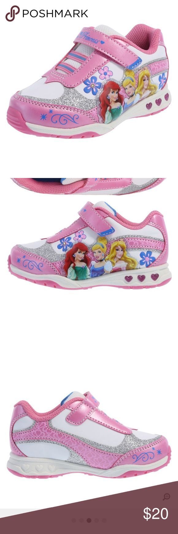 Girls princes light up runner 🏃♀️ Light up her world with this darling runner! It features her favorite Disney Princesses amidst flowers, glitter and whimsical designs, lighted elements that light up with every step, stretchy laces, strap with hook and loop close, padded tongue and collar, mesh lining, padded insole, and a non-marking, skid-resistant outsole. Manmade materials. #still looks brandnew as you can see👍 happy shopping! Disney Shoes Sneakers