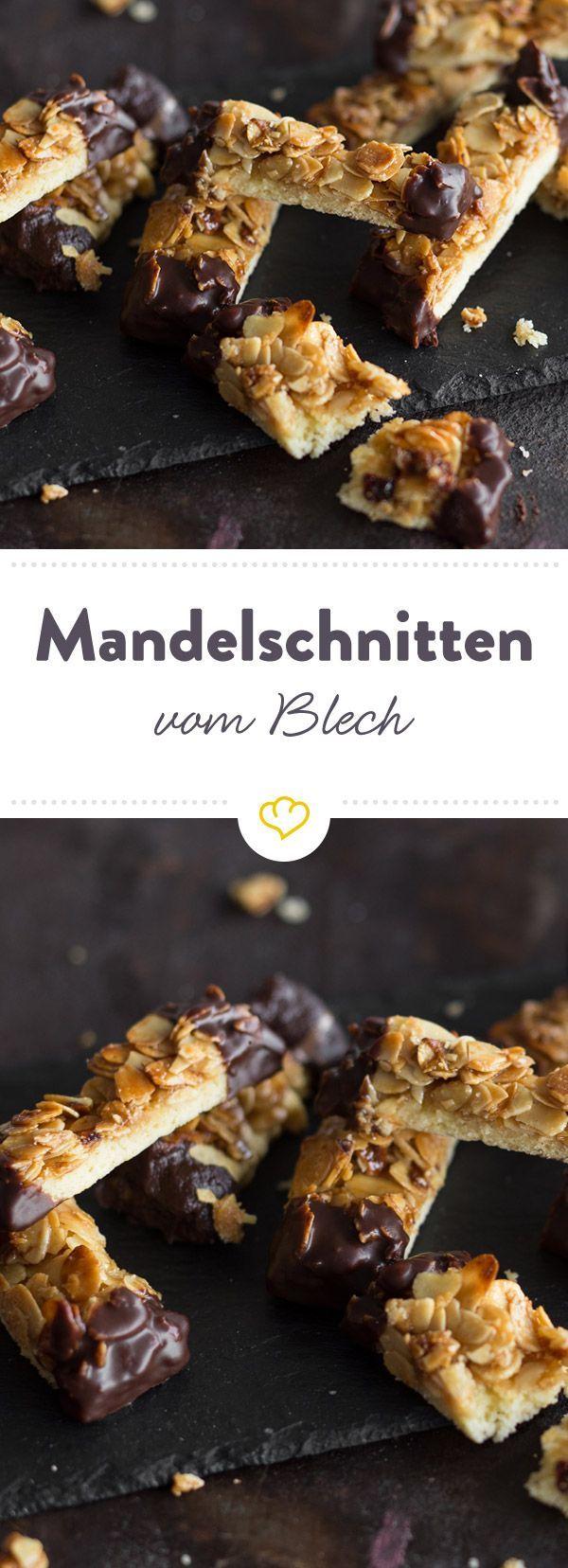 Hier spielen Mandeln die Hauptrolle und suhlen sich auf knusprigem Mürbeteig in einer Glasur aus köstlich süßem Honig und würziger Zimtbutter.