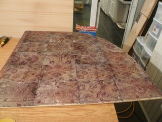 The completed chair mat:from pictures taken of a rug, printed on transfer paper, then heat transfer to plywood for w wonderful chair mat