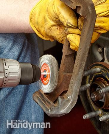 Clean the rust from the brake pad slide areas. How to Change Front Brake Pads: http://www.familyhandyman.com/automotive/car-brakes/how-to-change-front-brake-pads/view-all