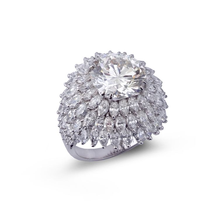An impressive diamond cocktail ring.Designed as a dome of marquise-shaped…