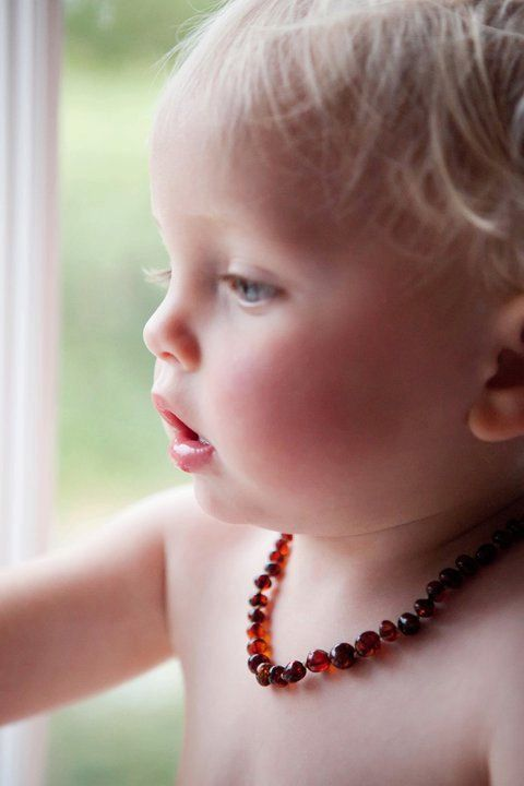Baby Baltic Amber Teething Necklace. Helps with Headaches and helps to calm baby, and inflammation. they do not chew it, the bead releases stuff thru the skin.http://youtu.be/J1SBcbZgS-U  Love this necklace.  Too bad I didn't know about it with my other kids.  No runny nose, red cheeks, and no need for teething tablets!
