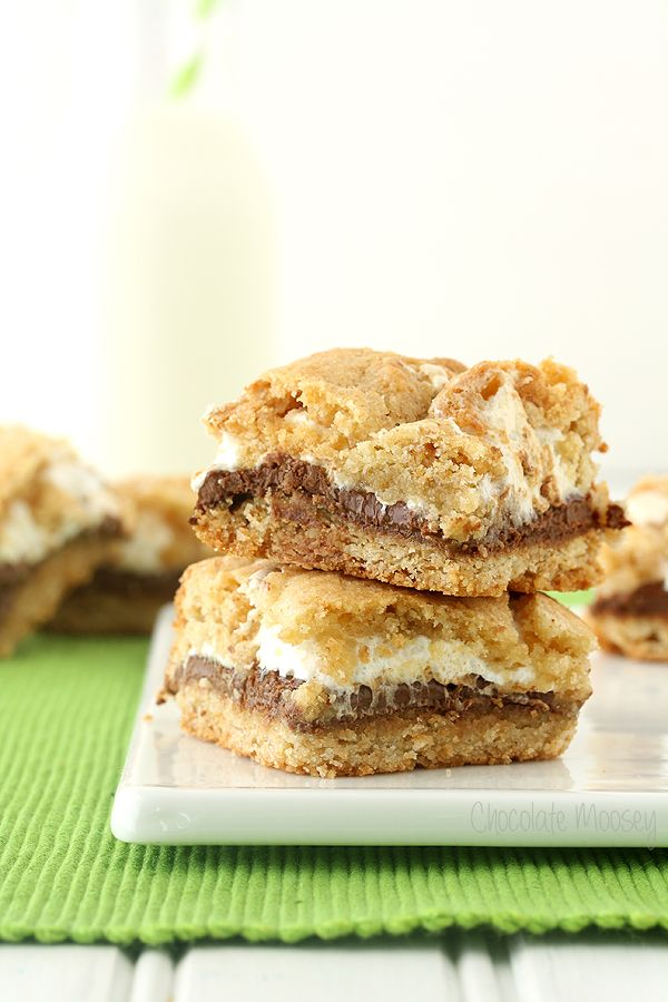 S'mores Cookie Crumb Bars turns the traditional s'mores into an irresistable dessert by replacing the graham crackers with two cookie layers.