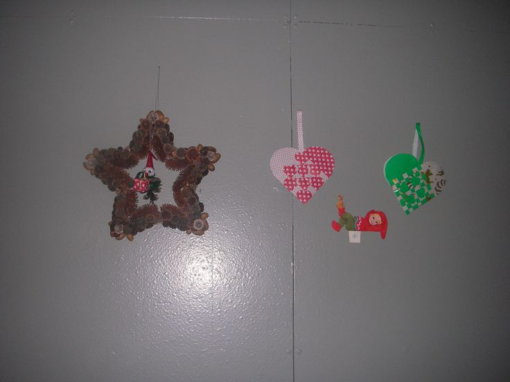 christmasdecoration.  the star is made of cones and nuts and have an elf in..