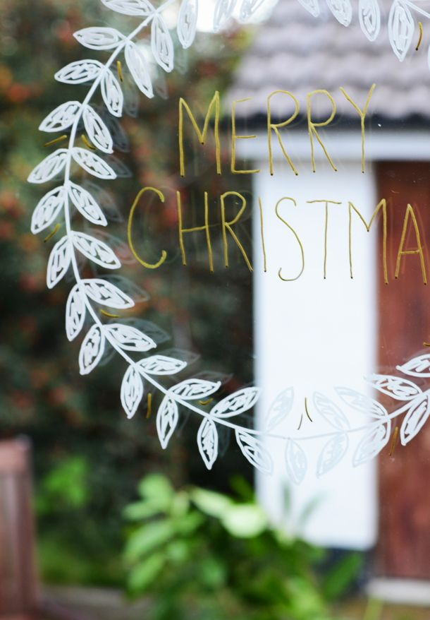 Christmas wreath with chalk marker for glass door