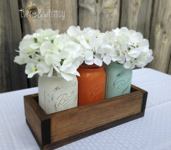 Bring farmhouse-style rustic charm to your home with this centerpiece for your table or mantle! Listing includes 3 quart-size mason jars, hand