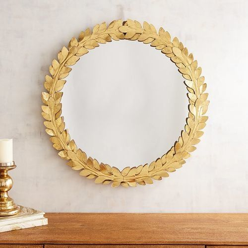 A symbol of victory and honor in ancient Rome, the laurel wreath adds timeless style wherever it goes. That's why we've surrounded our mirror with antiqued iron leaves painted a dazzling gold. Winner, winner!
