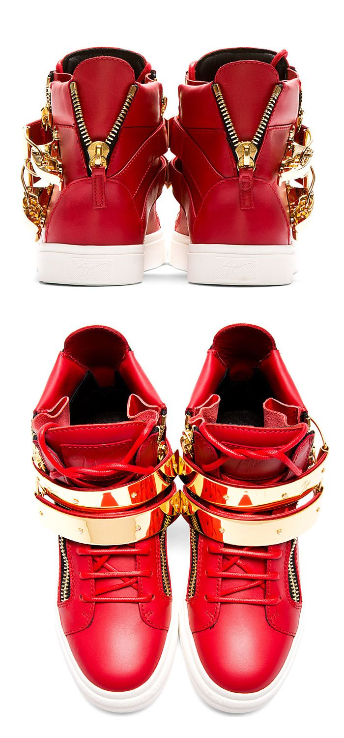 Buffed leather high-top sneakers in red. Round toe. Tonal lace-up closure. Logo patch at bellows tongue. Signature zipper accents at eyerow and heel. Straps at vamp with metal accent plaques in gold-tone and flip clasp closures. Designed by Giuseppe Zanotti. http://www.zocko.com/z/JFiWX