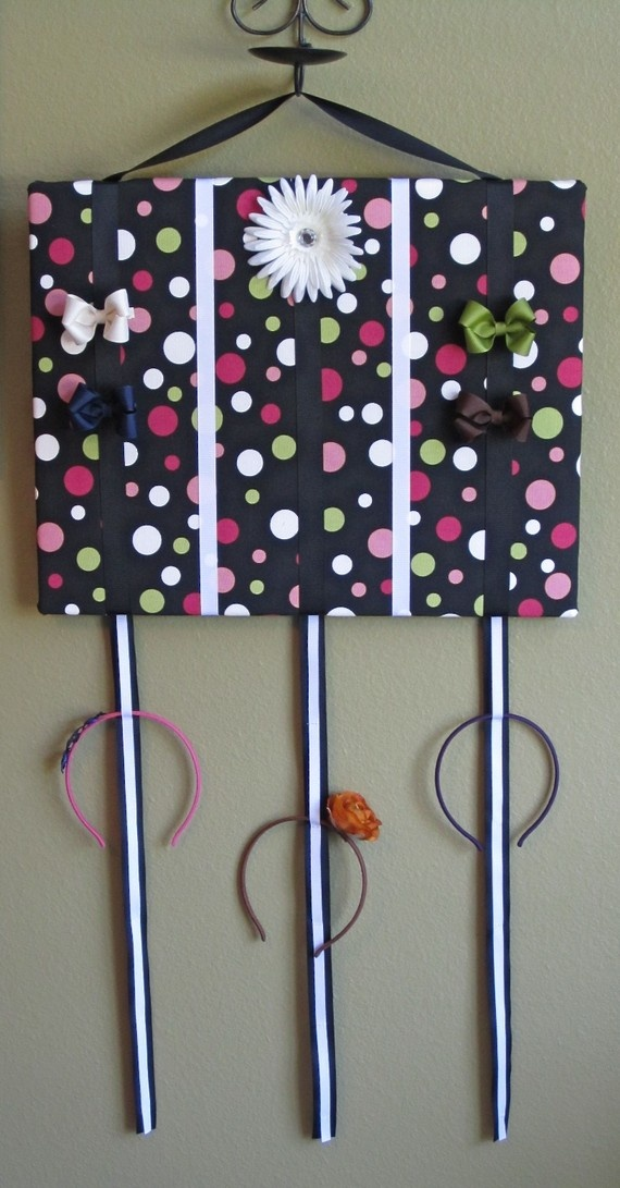 Add ribbon to the bottom of the bow board and sew every few inches for a place to hang headbands.