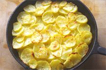 Potatoes Anna - cooked in the oven in a cast iron skillet - sound glorious!