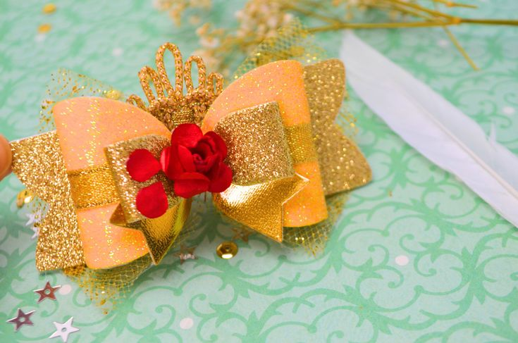 Beauty and the beast bow, new dress Belle bow hair clip, Disney princess Belle bow, glitter Belle bow, Belle hair clip, Princess Belle headb by Bellainspirationd on Etsy https://www.etsy.com/listing/499858366/beauty-and-the-beast-bow-new-dress-belle