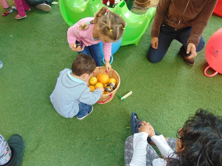 Let the little ones go on an orange scavenger hunt! We hid oranges in the garden and our toddlers had to find them and place them in a basket! So much fun!