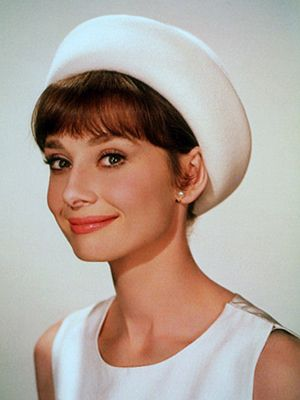 you can fit a lot of pills in this pillbox hat.  it is slightly warmer (bright winter?) white than her dress and looks great with her skin.  this hat may be too large for a classic gamine, audrey is FG.