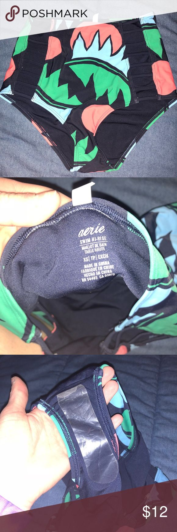 High waited bathing suit bottoms American eagle high waisted bathing suit bottoms. Still has liner. Never worn but tag got lost. Cut outs along the side. Colors: navy, coral, green, and light blue American Eagle Outfitters Swim Bikinis