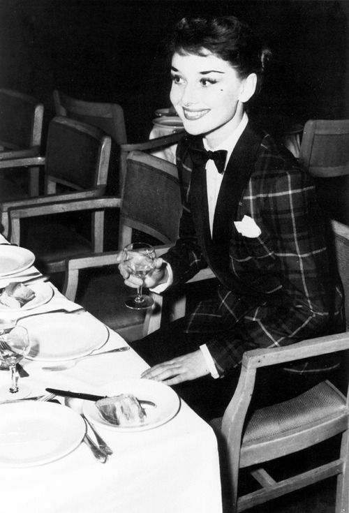 Audrey Hepburn dines out in London's West End, wearing a tartan jacket and bow tie, October 3, 1950.