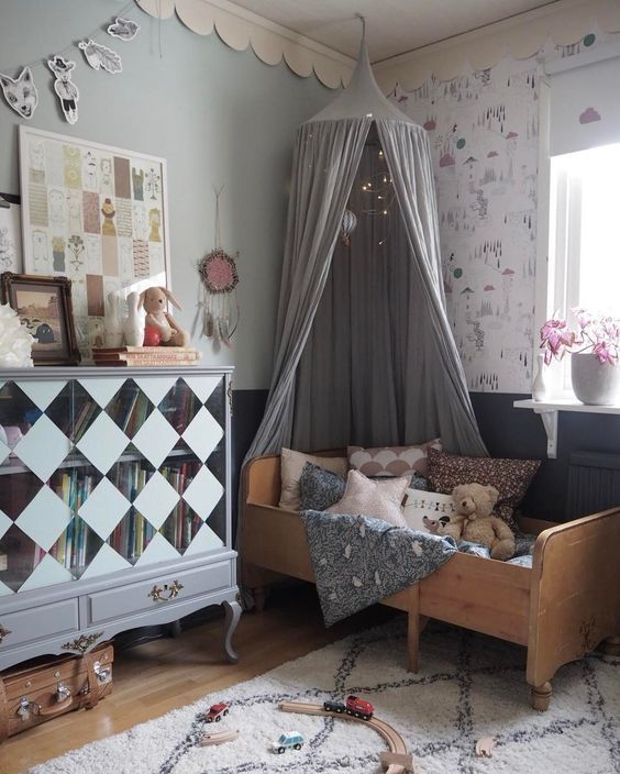 An old bed, an old cabinet, vintage suitcase for storage, vintage fabric and more. Nothing matches yet it all comes together beautifully creating a charming and imaginative space for a kid http://petitandsmall.com/mixandmatch-vintage-kids-rooms/