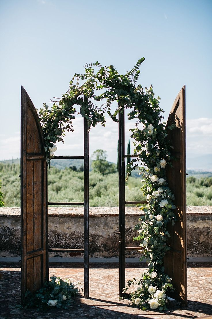 Outdoor Ceremony Vintage Wooden Archway White Roses Greenery Rustic Chic Wedding Ideas In Tuscany