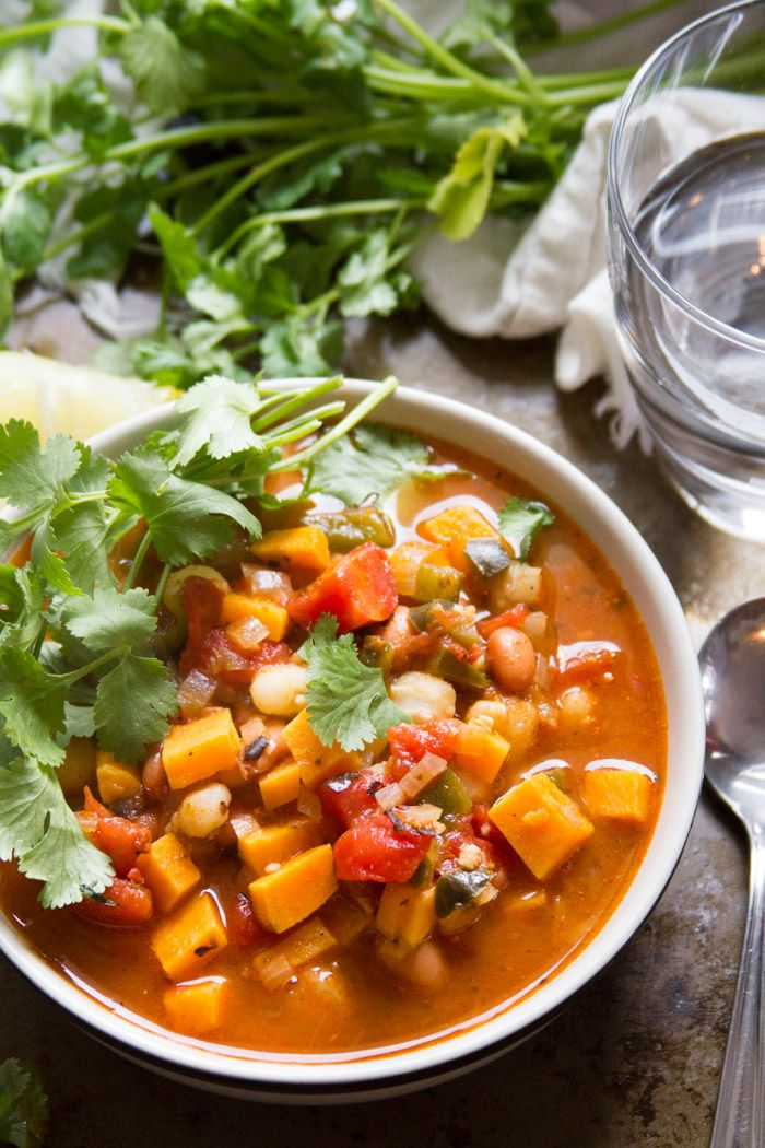 Sweet potato chunks, hominy and pinto beans are simmered in smoky, spicy chipotle broth to make this warming vegan posole.