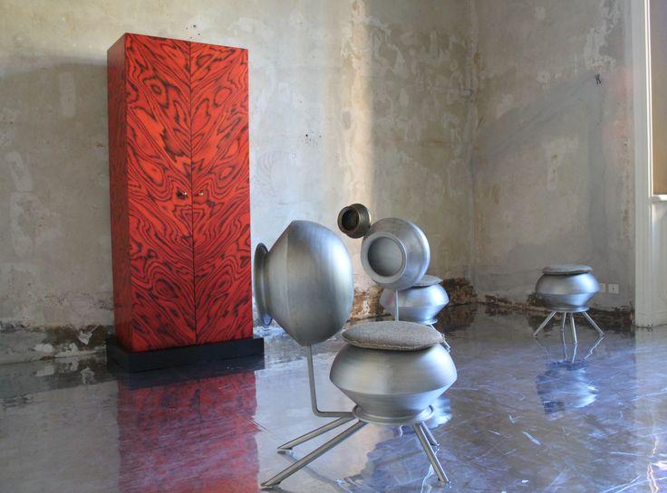 Gunjan Gupta, Bartan Chair    2014 Limited edition    1 AP   1 Prototype, Aluminium frame, brass, fabric. Country of Realization - India #gunjangupta #bartanchair #limitededition #prototype #aluminiumframe #brass #fabric #detail #indiandesigner #erastudioapartmentgallery #milan #italy #interiordesign #furniture #chair #madeinindia #erastudio #collectible #nairobi #sottsass #red #black #historic