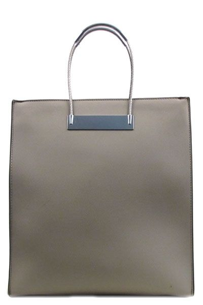 The Everything Tote features a large size tote style bag with a zipper opening and silver trimming details. Two inner pockets with zipper closures. Zipper pocket on back. Includes detachable matching