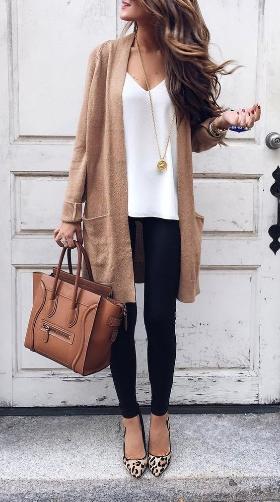 I like the camel colored long sweater with the black leggings/pants and the leopard print shoes to tie it all together