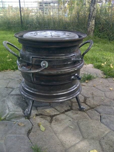 Len Wilcox December 4 · saw a similar stove made out of rims so my dad and I put this one together. Actually used 2 pickup rims, two put together and welded, then cut the center out of the top and used the center from a semi dulley rim with a plate to fill the center of it. We then one upped it with rail road spikes for the legs and used horse shoes for handles, door hinges and latch.
