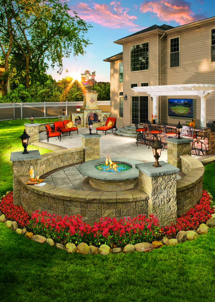 Would you enjoy this outdoor living space in your backyard? Pergolas and fire pits from Cambridge pavers provide the best designs for relaxation.