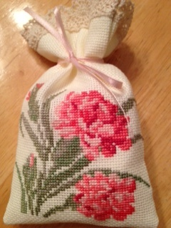 Counted cross stitch sachet. Carnation - January flower