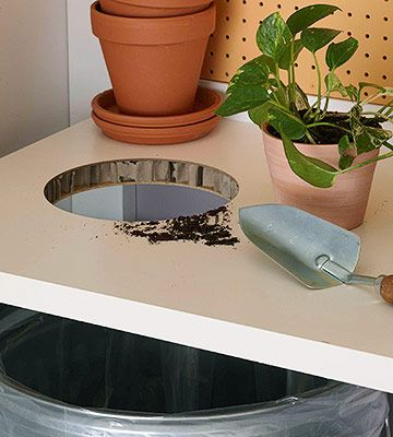 Make clean-up easy by cutting a hole in the tabletop.  I need to remember this!