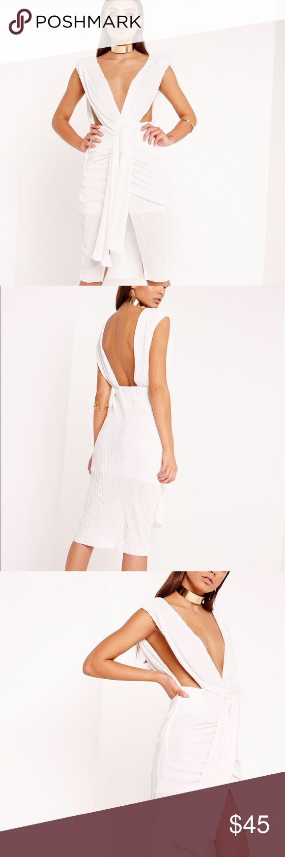 MISSGUIDED PLEATED WHITE DRESS Make a dramatic entrance anywhere you go in this white midi dress! in a figure flattering pleated finish in a soft premium material, this ruched detailed dress is a major must have. with wrap over detailing to the front to create a tied effect and cut out detailing to each side, this plunging beaut will turn up the heat! Missguided Dresses Midi