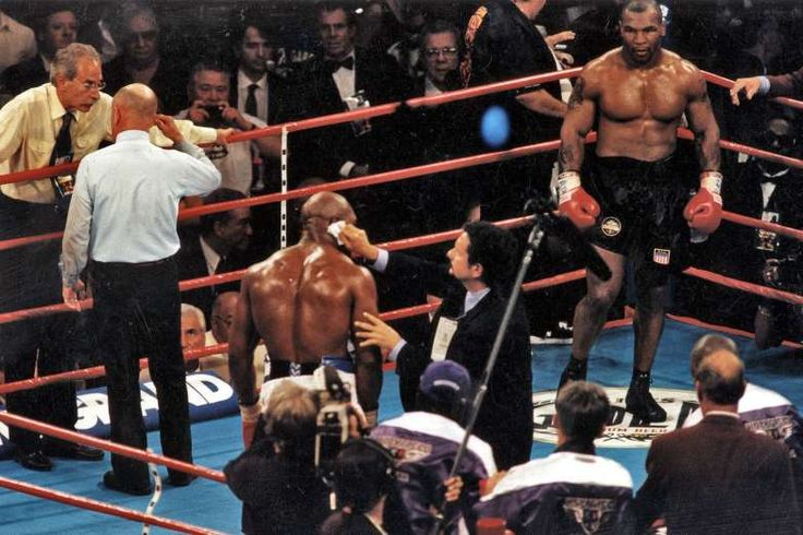 June 28,  1997: TYSON BITES HOLYFIELD'S EAR  -   In a wild rematch, Evander Holyfield retains the WBA heavyweight boxing championship after his opponent, Mike Tyson, is disqualified for biting Holyfield's ear during the third round of their fight in Las Vegas.