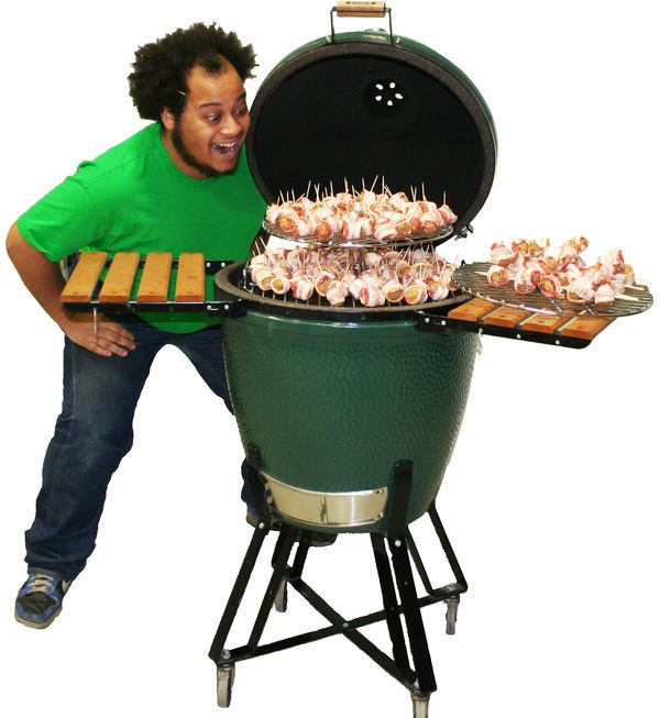 The Big Green Egg Camping BBQ Grills Simultaniously Smoke and Grill Meals #carnivore #gifts trendhunter.com