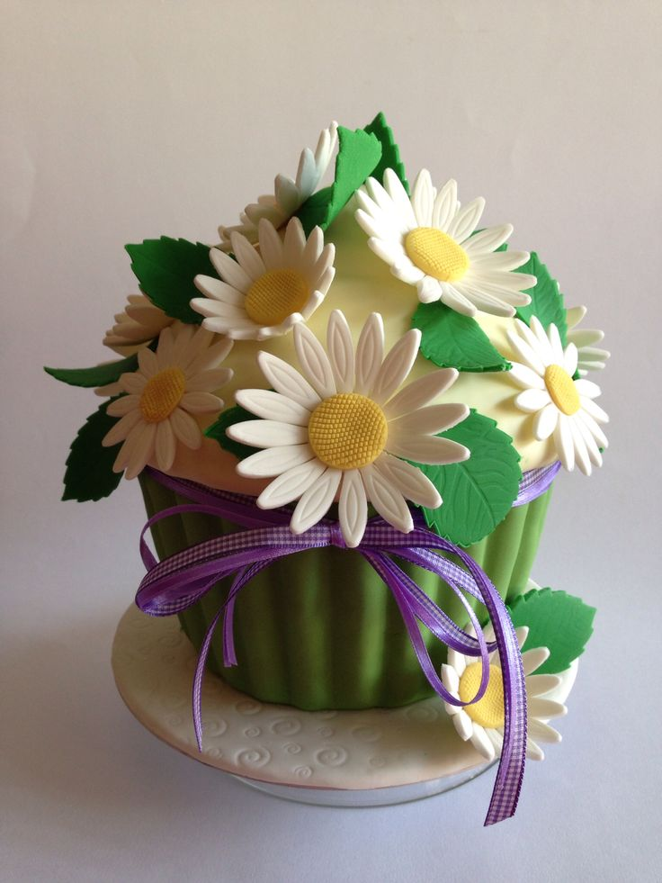 Giant cupcake with daisies                                                                                                                                                                                 More