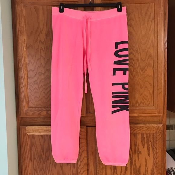 "Victoria's Secret PINK Neon Sweatpants Bright neon pink. ""Love Pink"" in black on the side. Never worn. Tags attached. Size Medium. Victoria's Secret Pants Track Pants & Joggers"