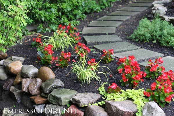 Curved concrete paver path   Here's a bunch of creative ideas for designing garden paths and walkways plus DIY stepping stone tutorials. Whether it's stone, brick, hypertufa, or concrete pavers, there's lots of things you can do with simple materials for a great look.