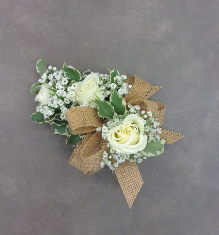 Rustic corsage with white roses and babies breath with burlap bow by Nancy at Belton Hyvee.
