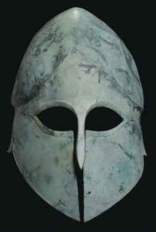 A GREEK BRONZE CORINTHIAN HELMET ARCHAIC PERIOD, CIRCA LATE 6TH CENTURY B.C.