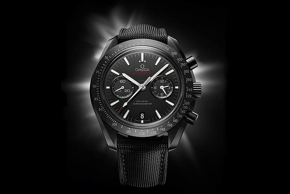 The Omega Speedmaster Dark Side of the Moon features a matte black ceramic case and a black Cordura strap.