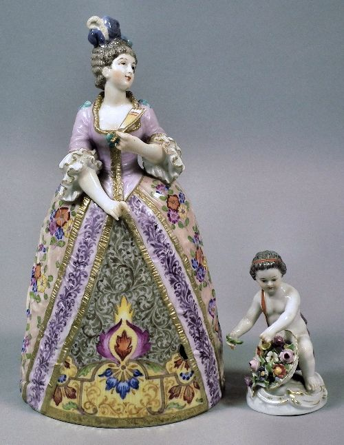Meissen lady with fan in 18th Century dress, 8ins high and Meissen porcelain figure of a putto with a basket of flowers,20th Century, 3.25ins high (646x500)