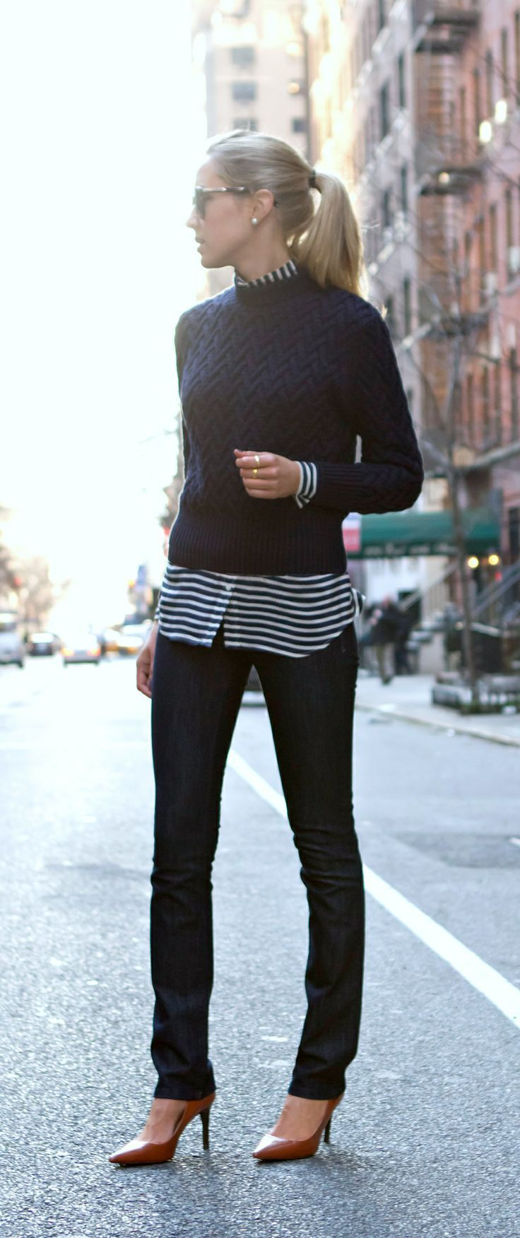 A navy crew-neck pullover and black skinny jeans are perfect for both running errands and a night out. Polish off the ensemble with brown leather pumps.  Shop this look for $79:  http://lookastic.com/women/looks/sunglasses-crew-neck-sweater-dress-shirt-skinny-jeans-pumps/4483  — Black Sunglasses  — Navy Crew-neck Sweater  — White and Navy Horizontal Striped Dress Shirt  — Black Skinny Jeans  — Brown Leather Pumps