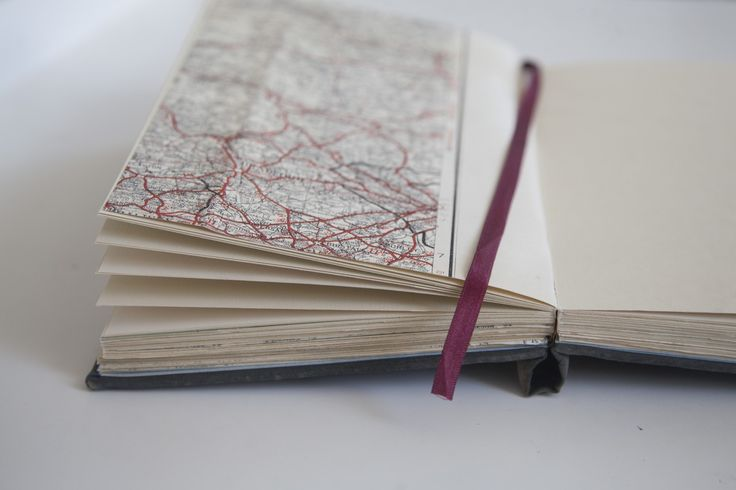 Maps personal to the couple have been incorporated into the bespoke handmade wedding guestbook