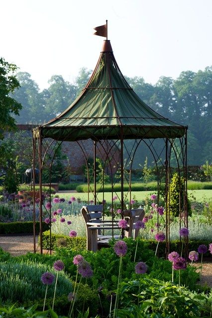 A hexagonal gazebo from Room in the Garden. Click the link for dozens more garden room ideas