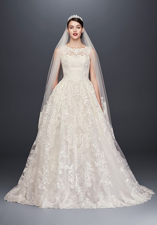 Yards of opulently beaded and appliqued tulle create softly folded pleats in the grand skirt of this stunning wedding dress. Covered in 5,000 beads and sequins, and finished with scalloped lace trim around the hemline, this Oleg Cassini ball gown is truly breathtaking to behold.